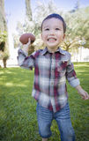 Cute Young Mixed Race Boy Playing Football Outside Royalty Free Stock Photos