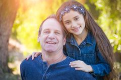 Cute Young Mixed Race Girl And Caucasian Grandfather Outdoors. Cute Young Mixed Race Girl And Caucasian Grandfather Having Fun Outdoors royalty free stock photo