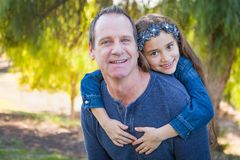 Caucasian Grandfather and Cute Young Mixed Race Girl Outdoors. Cute Young Mixed Race Girl And Caucasian Grandfather Having Fun Outdoors royalty free stock photography