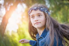 Cute Young Mixed Race Girl Having Fun Outdoors. Cute Young Mixed Race Girl Having Fun Playing Outdoors royalty free stock photography
