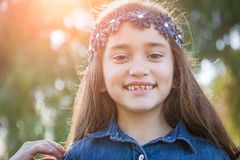 Pretty Young Mixed Race Girl Having Fun Outdoors. Cute Young Mixed Race Girl Having Fun in the Sunshine Outdoors royalty free stock images