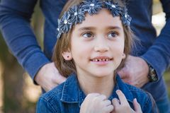 Cute Young Mixed Race Girl with Her Dad Outdoors. Cute Young Mixed Race Girl Having Fun Outdoors stock photography