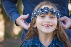 Happy Young Mixed Race Girl with Daddy Outdoors. Cute Young Mixed Race Girl Having Fun Outdoors stock photos