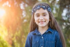 Adorable Mixed Race Girl Playing in the Sunshine Outdoors. Cute Young Mixed Race Girl Having Fun in the Sun Outdoors stock images