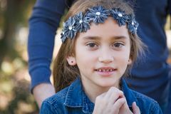 Innocent Young Mixed Race Girl with Her Dad Outdoors. Cute Young Mixed Race Girl Having Fun Outdoors royalty free stock photos