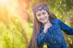Happy Mixed Race Girl Running in the Sunshine Outdoors. Cute Young Mixed Race Girl Having Fun in the Sun Outdoors royalty free stock photo
