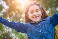 Exited Young Mixed Race Girl Having Fun Outdoors. Cute Young Mixed Race Girl Having Fun Outdoors stock images