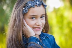 Portrait of a Cute Young Mixed Race Girl Outdoors. Cute Young Mixed Race Girl Portrait Outdoors stock photography