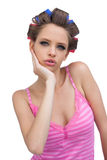 Cute young model posing wearing hair curlers Stock Photography