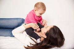 Cute young mom and her baby girl Royalty Free Stock Photos