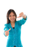 Cute young Muslim girl giving a thumb up sign over white backgro. Und, focus on thumb photo Stock Photography