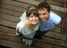 Cute young newly weds looking up royalty free stock photos