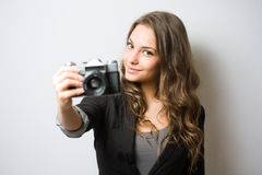 Cute young photographer. Stock Photo
