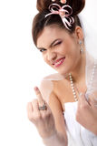 Cute young playful bride showing wedding ring Royalty Free Stock Photo