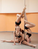 Cute young pole dancers posing with pylon Stock Photos
