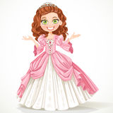 Cute young princess with curly brown hair in a pink dress Royalty Free Stock Photography