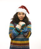 Cute young real african hipster girl in santas red hat isolated on white background waiting for winter Christmass Royalty Free Stock Photo