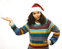 Cute young real african hipster girl in santas red hat isolated Royalty Free Stock Photography