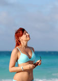 Cute young redhead woman enjoy sun at the ocean shore Royalty Free Stock Photos