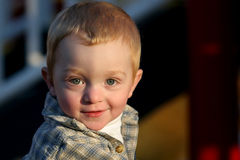Cute young redheaded boy. Portrait of an adorable, young, redheaded boy in the late afternoon sun Royalty Free Stock Photography