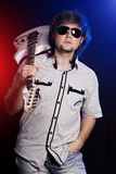 Cute young rock musician with a white guitar Stock Image