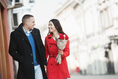 Cute, young, romantic couple walking outdoors Royalty Free Stock Photo