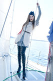 A cute young sailor girl on a boat Stock Images