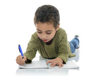 Cute Young Schoolboy Writing Stock Image
