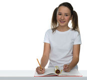 Cute young schoolgirl in class Royalty Free Stock Photography