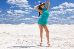 Cute young sexy woman in green dress on the snow Royalty Free Stock Photo