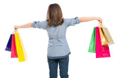 Cute and young shopping girl from behind Royalty Free Stock Image