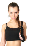 Cute young sportswoman holding her plait Stock Images