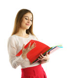 Cute young student girl read folders Royalty Free Stock Images