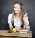 Cute young student near blackboard with copy book calculator pen, copy space Stock Photography