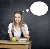 Cute young student near blackboard with copy book calculator pen, copy space Stock Image