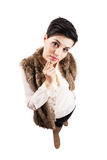 Cute young stylish woman curious looking at camera. Stock Photography
