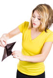 Cute young surprised, unhappy, puzzled woman, girl holding an empty wallet Royalty Free Stock Image