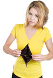 Cute young surprised, unhappy, puzzled woman, girl holding an empty wallet Royalty Free Stock Images