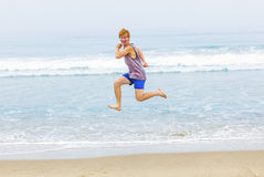 Cute young teenage boy has fun at the beach Stock Photos