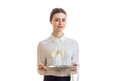 Cute young waitress in uniform with trey Stock Image