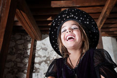 Cute Young WitchLaughing Royalty Free Stock Image