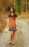 Cute young woman in the autumn forest Royalty Free Stock Photos