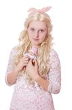 Cute young woman with baby doll Royalty Free Stock Image
