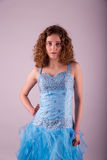 Cute young woman in blue dress Stock Photography