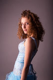 Cute young woman in blue dress Stock Photo
