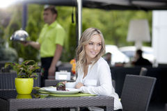 Cute young woman in cafe Stock Image