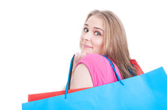 Cute young woman in closeup holding bags and doing shopping Royalty Free Stock Images