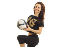 Cute young woman coached football with ball. Isolated on white background Stock Photo