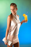 Cute young woman with cocktail Royalty Free Stock Image