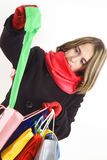Cute young woman with colored shopping bags Stock Images